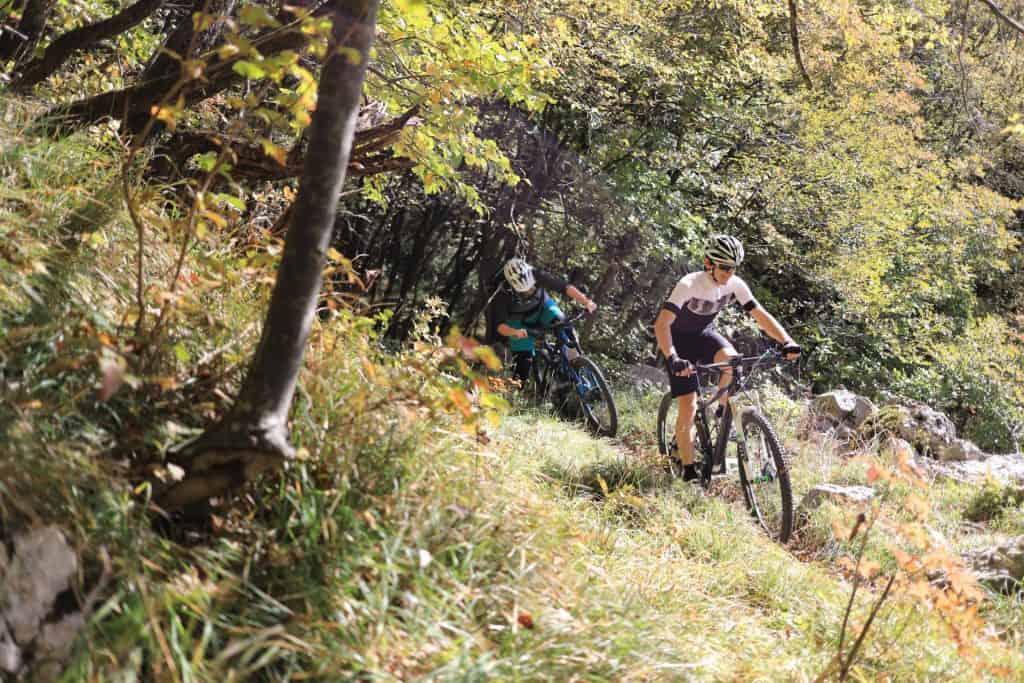 Mountainbiking in Slovenia. MTB trails above Vipava Valley. Couple riding rental mountain bikes by RockVelo.
