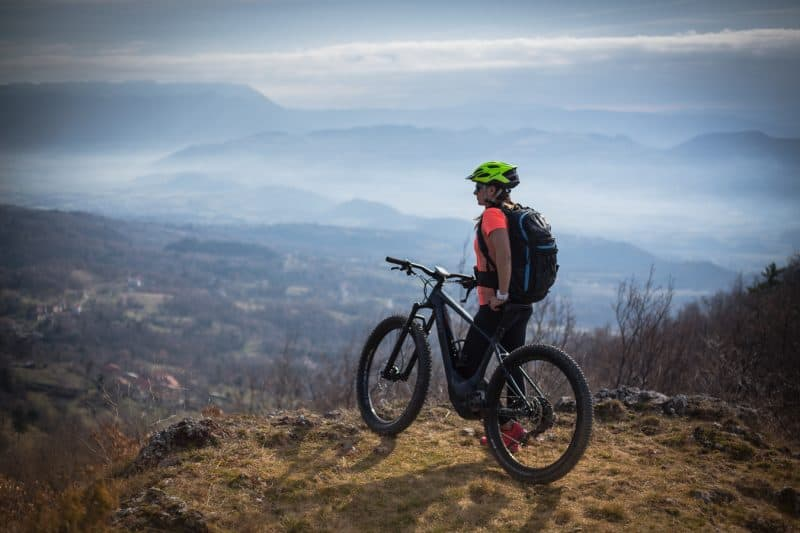 Lady riding ebike on top of vipava valley