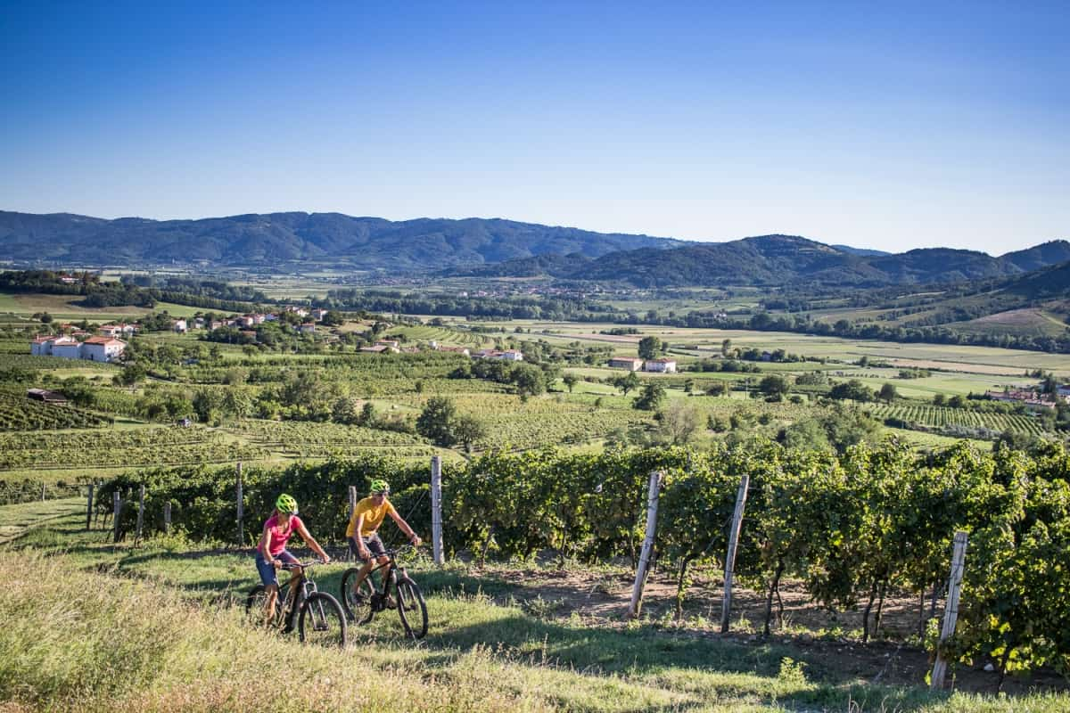 Couple riding E-bikes in the Vipava valley Slovenia. Photo by Anita Ferjancic, RockVelo
