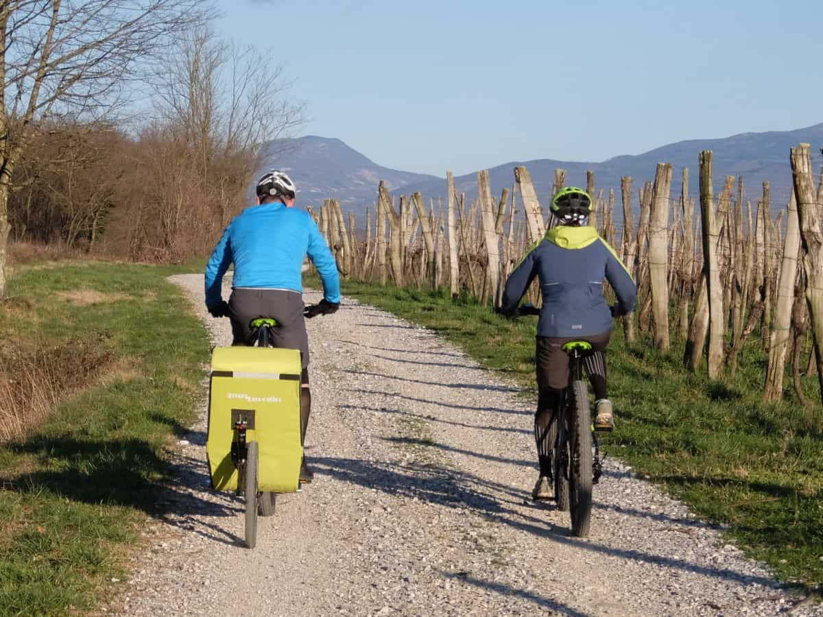 Couple riding ebikes in the Vipava valley. Rental shop RockVelo