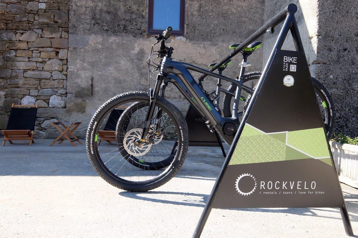 Rental e-bikes by RockVelo in Slovenia. Rental shop setting.