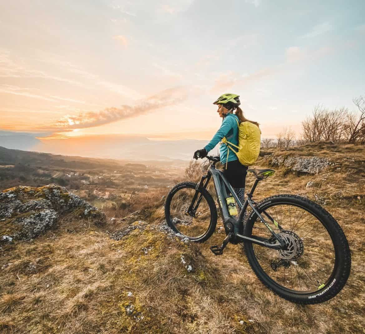 Woman with rental e-bike above Vipava valley. RockVelo Tours