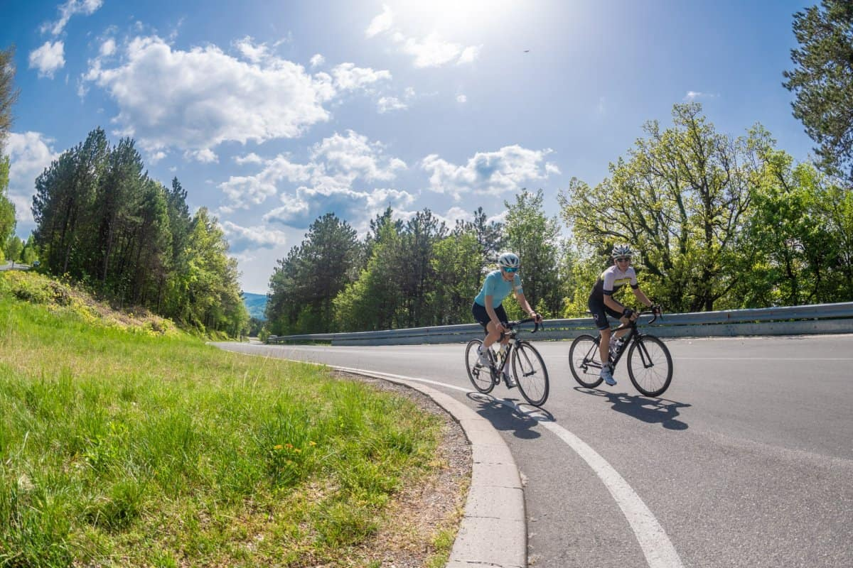 A couple on Road Bikes in Slovenia. Tour by RockVelo.