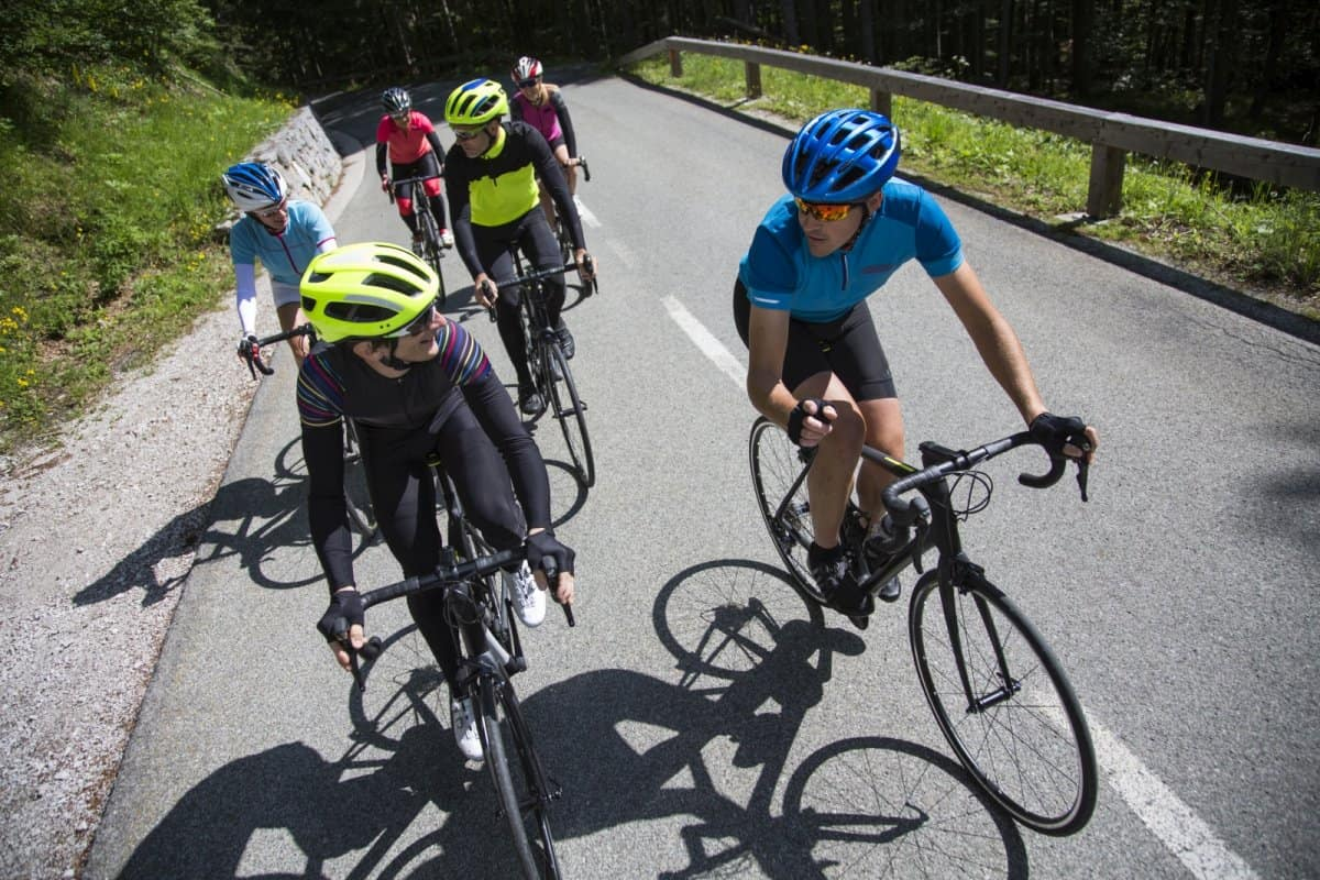 Group of road cyclist riding vrsic pass in Slovenia. Road tour by RockVelo